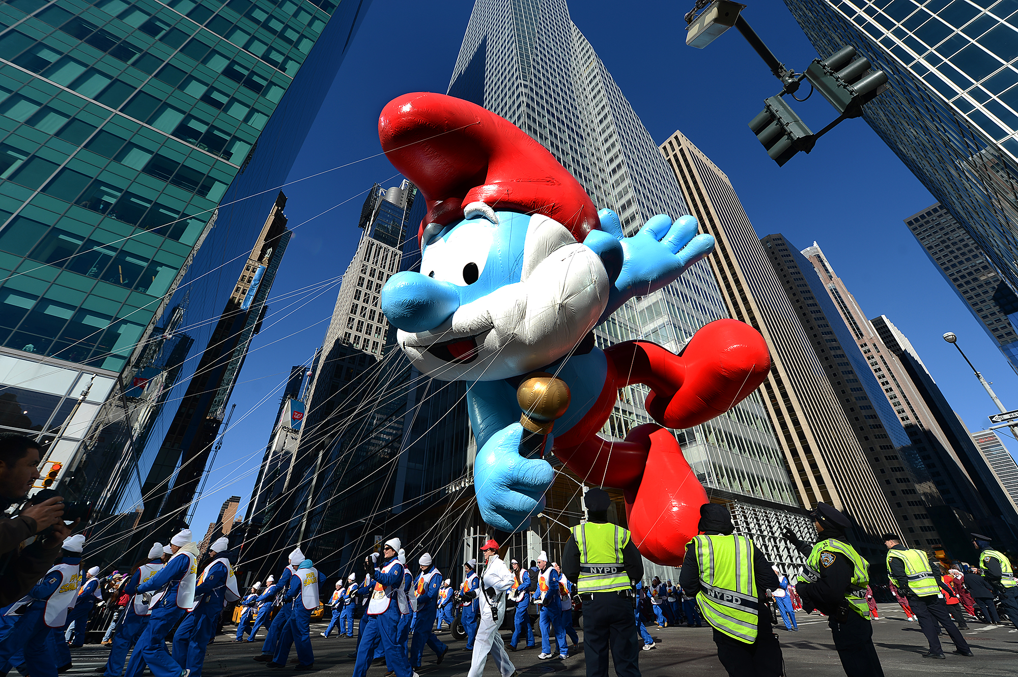 NEW YORK, NY - NOVEMBER 28: The Papa Smurf balloon floats over the streets during the 87th Annual Macy's Thanksgiving Day Parade on November 28, 2013 on November 28, 2013 in New York City. (Photo by Cem Ozdel/Anadolu Agency/Getty Images)
